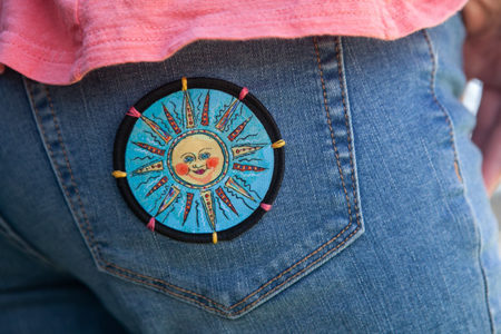 Sun Patch on jeans by Mary Butler